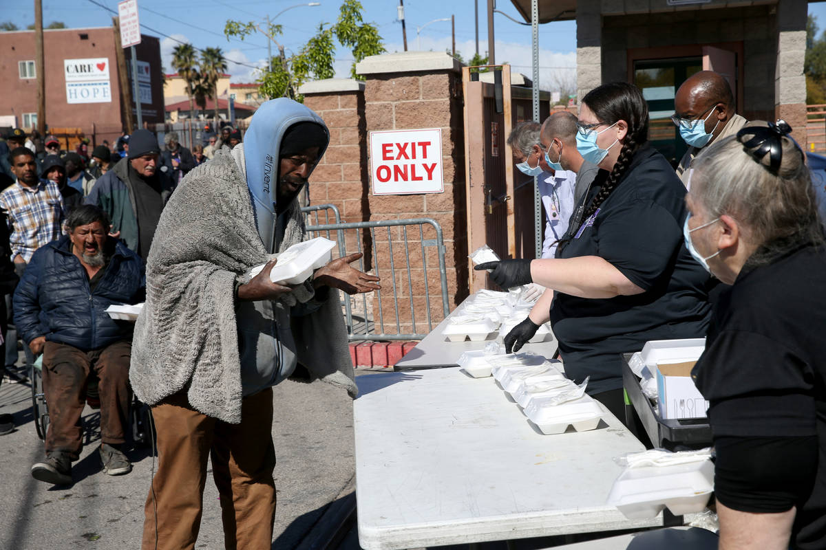 Michael Brown grabs a to-go lunches at Catholic Charities on Foremaster Lane in Las Vegas Thurs ...