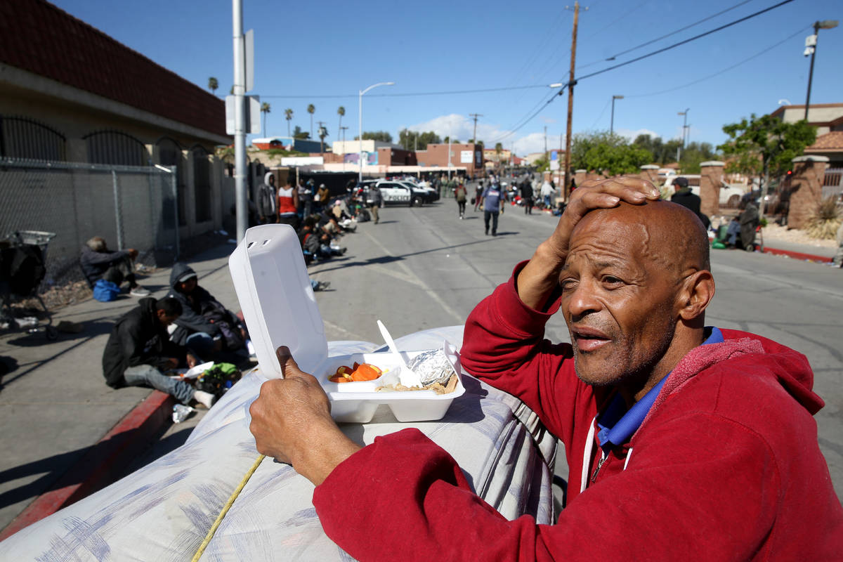 Tony Brown, 64, with his to-go lunch from Catholic Charities on Foremaster Lane in Las Vegas Th ...