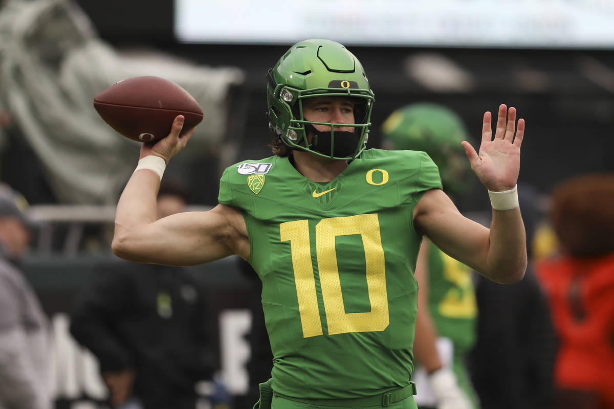 Oregon quarterback Justin Herbert (10) warms up prior to the start of an NCAA college football ...