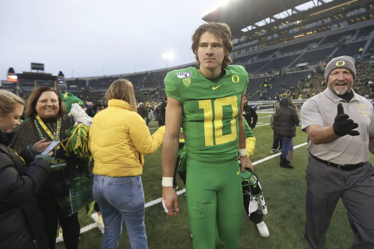Oregon quarterback Justin Herbert (10) walks off field following an NCAA college football game ...