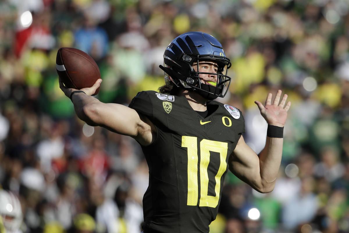 Oregon quarterback Justin Herbert passes against Wisconsin during first half of the Rose Bowl N ...