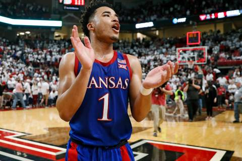 FILE - In this March 7, 2020, file photo, Kansas' Devon Dotson (1) celebrates after an NCAA col ...