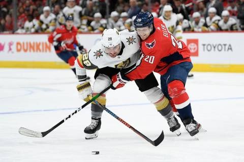 Washington Capitals center Lars Eller (20), of Denmark, and Vegas Golden Knights left wing Will ...