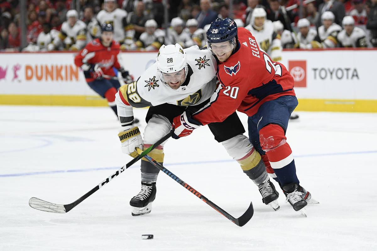 Washington Capitals center Lars Eller (20), of Denmark, and Vegas Golden Knights left wing Will ...
