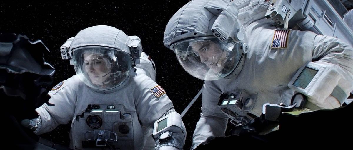 Sandra Bullock as Ryan Stone and George Clooney as Matt Kowalski star in Warner Bros. Pictures& ...