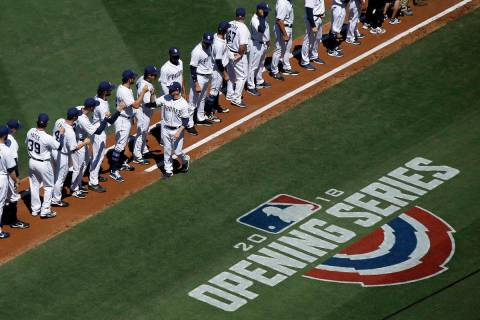 San Diego Padres manager Andy Green, center, greets his team after being introduced before an o ...