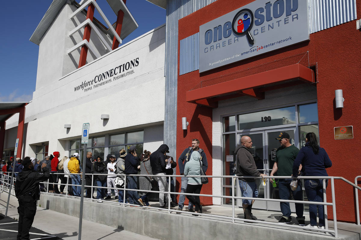 In a March 17, 2020, file photo, people wait in line for help with unemployment benefits at the ...