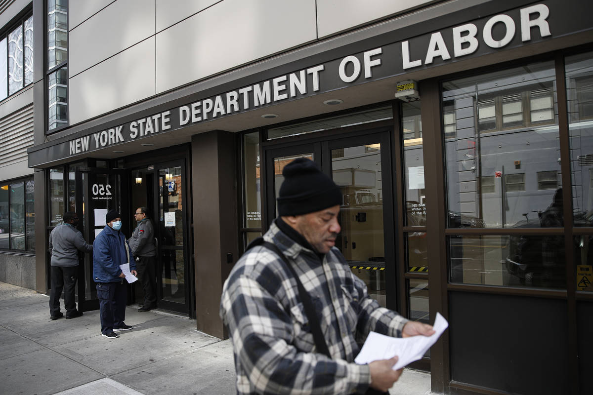 In a March 18, 2020, file photo, visitors to the Department of Labor are turned away at the doo ...