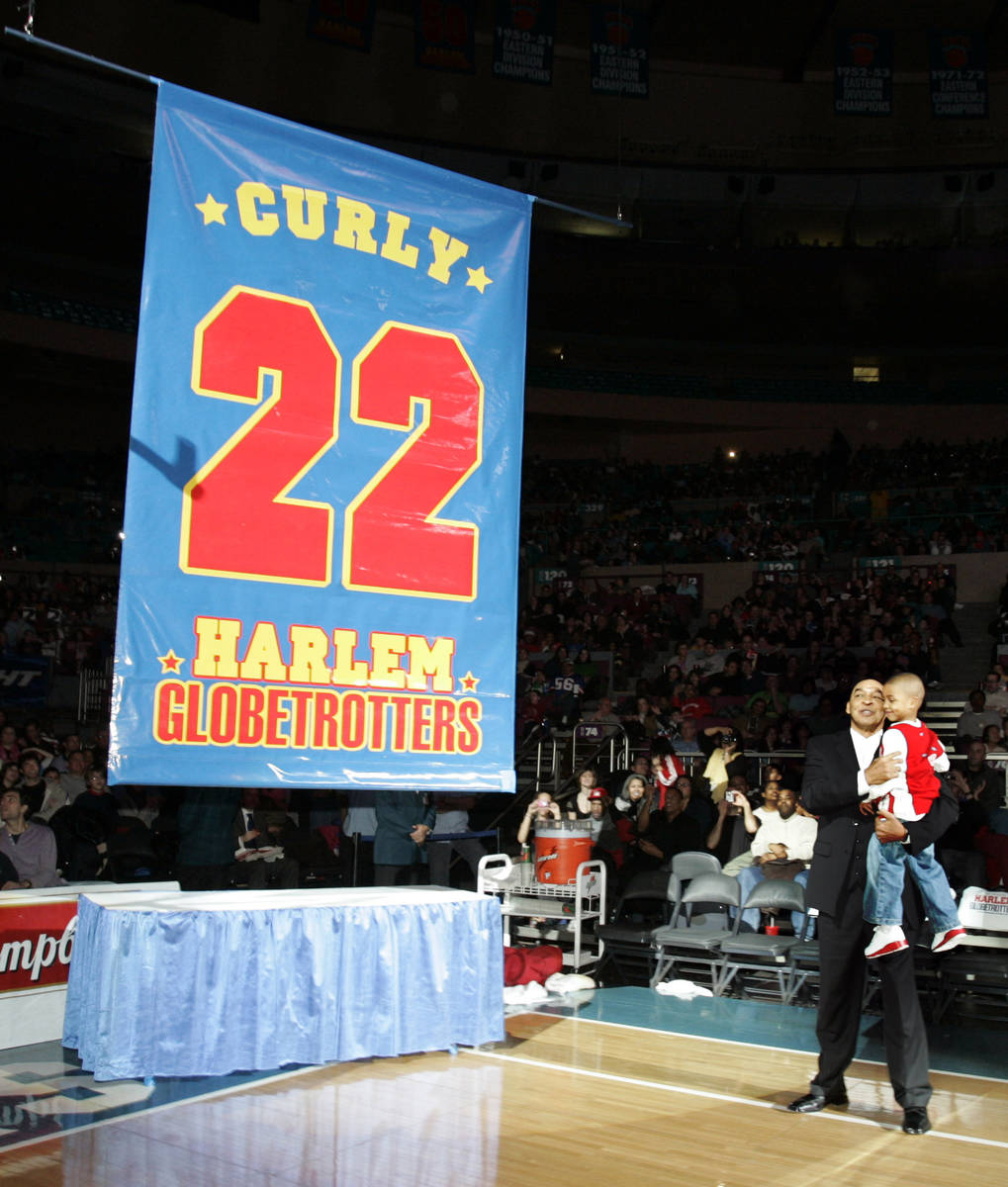 """FILE - In this Feb. 15, 2008, file photo, Harlem Globetrotters' Fred """"Curly"""" Neal loo ..."""