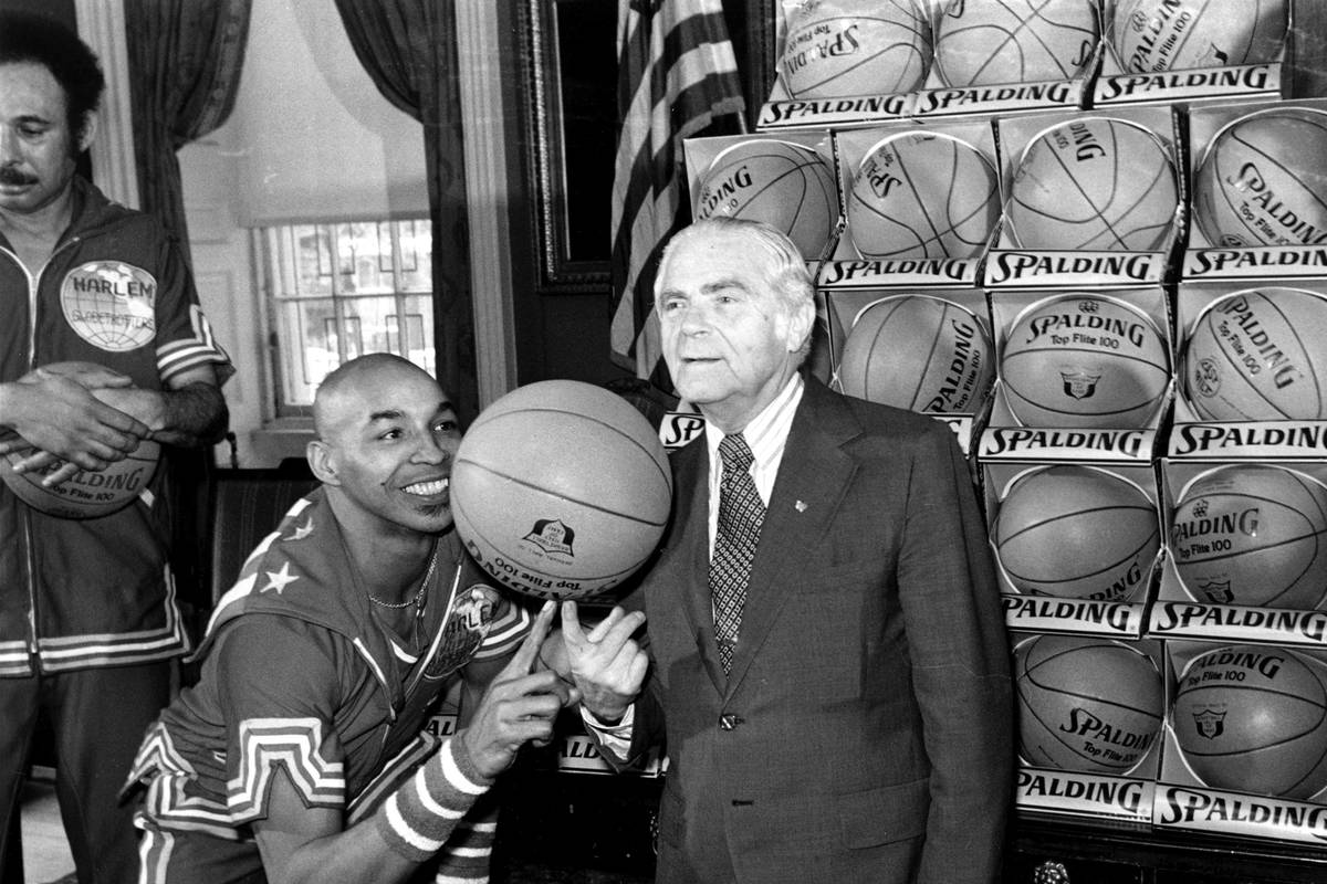 """FILE - In this Feb. 15, 1977, file photo, the Harlem Globetrotters' Fred """"Curly"""" Neal ..."""