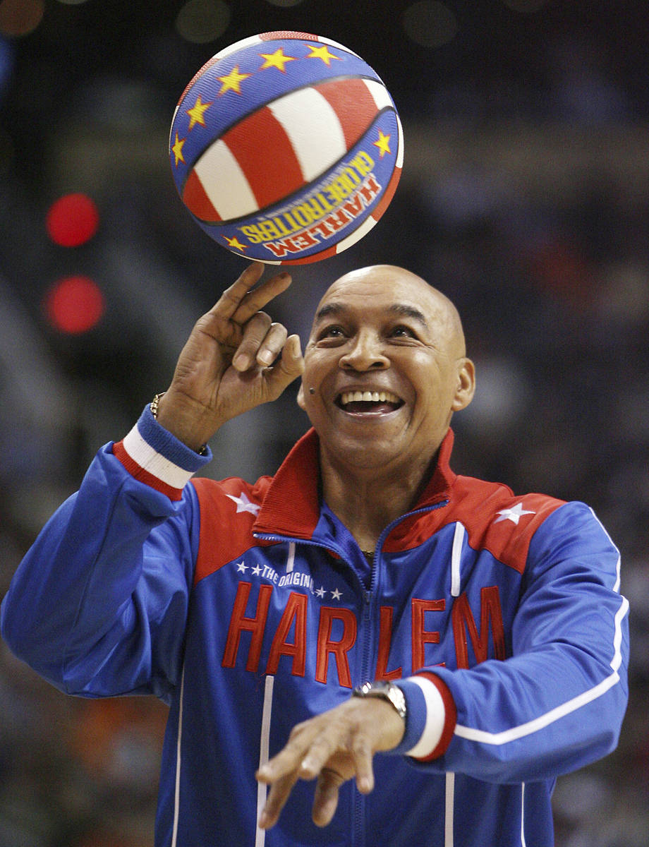 """The Harlem Globetrotters' Fred """"Curly"""" Neal performs during a timeout in the second q ..."""