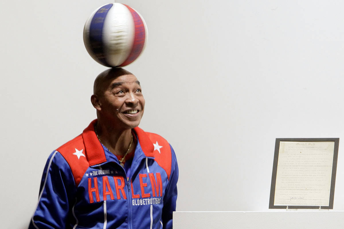 """FILE - In this Dec. 10, 2010, file photo, Harlem Globetrotters Fred """"Curly"""" Neal spin ..."""