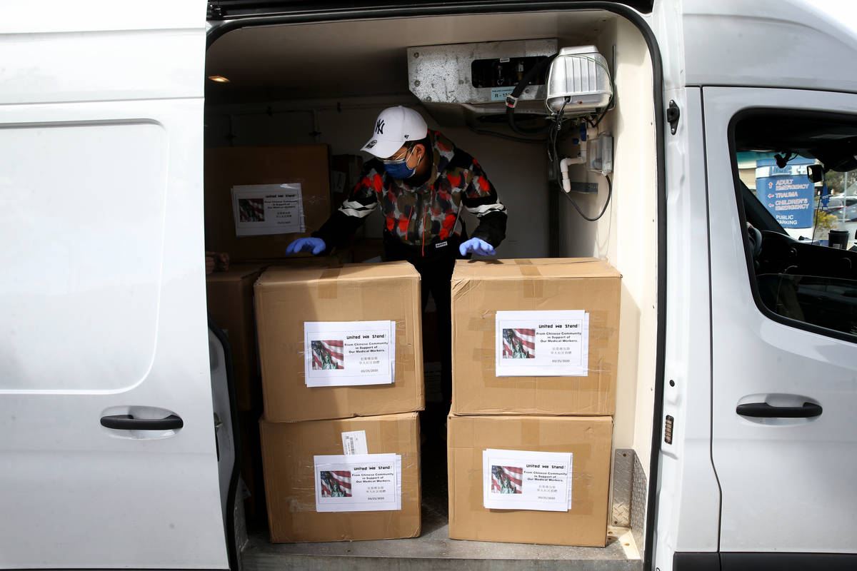Zihan Chen loads 33,000 surgical masks and 500 N95 respirator masks for donation to University ...