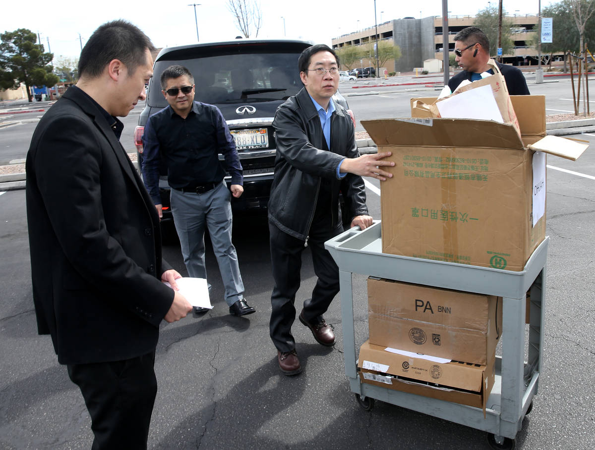 Representatives of Ohjah Japanese Steakhouse in Las Vegas load a donation to University Medical ...
