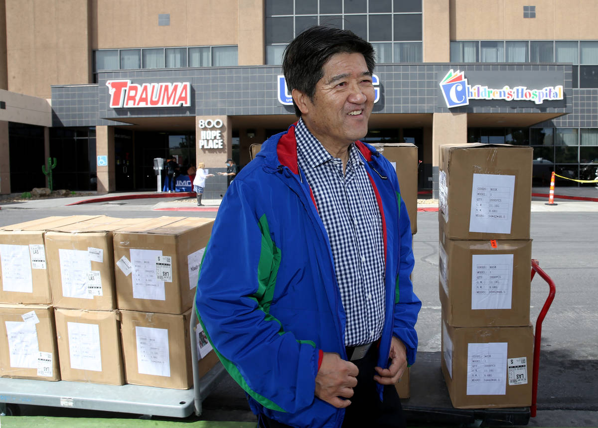 Jiaming Zhang, secretary of the Nevada Chinese Association, with 33,000 surgical masks and 500 ...
