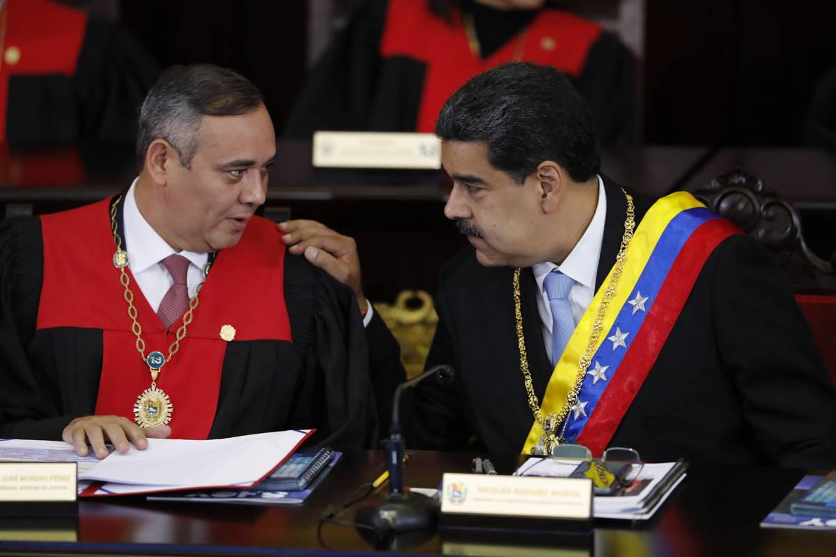 FILE - In this Jan. 31, 2020 file photo, Venezuelan President Nicolas Maduro, right, speaks wit ...