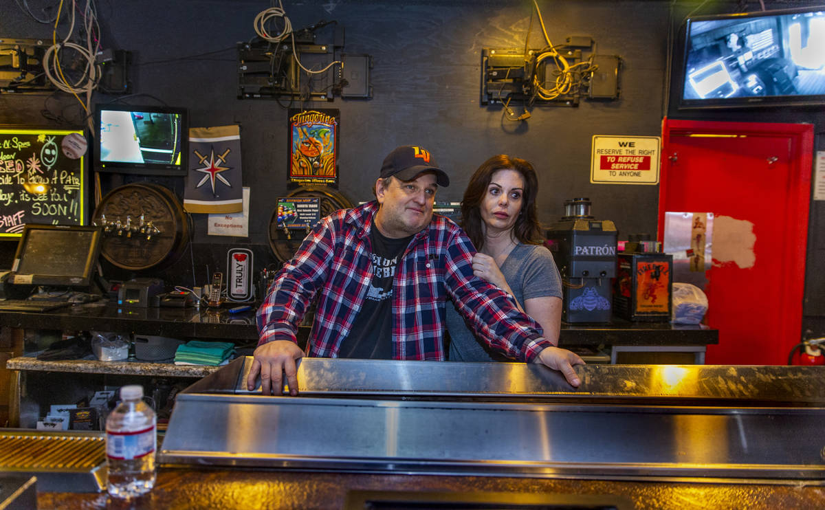 Saddle N Spurs Saloon owners Bobby and Melissa Kingston behind their bar as they close up for t ...