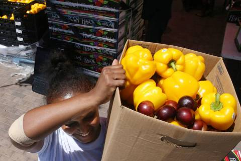 Zenebech Beyene picks up food during a food bank distribution at Veterans Village in downtown L ...
