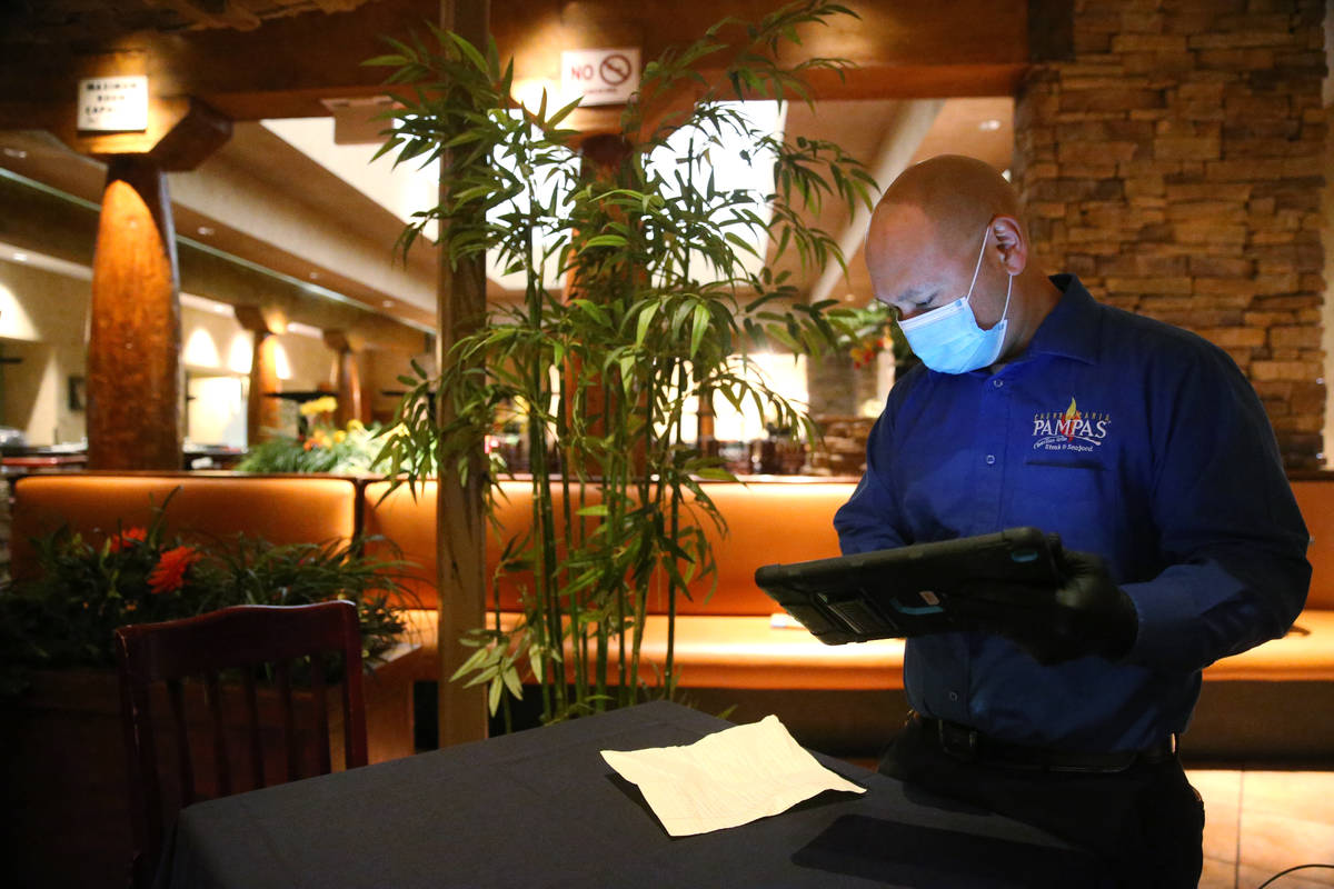 Lawrence D., floor manager of Pampas Las Vegas, processes an order at the restaurant in the Mir ...