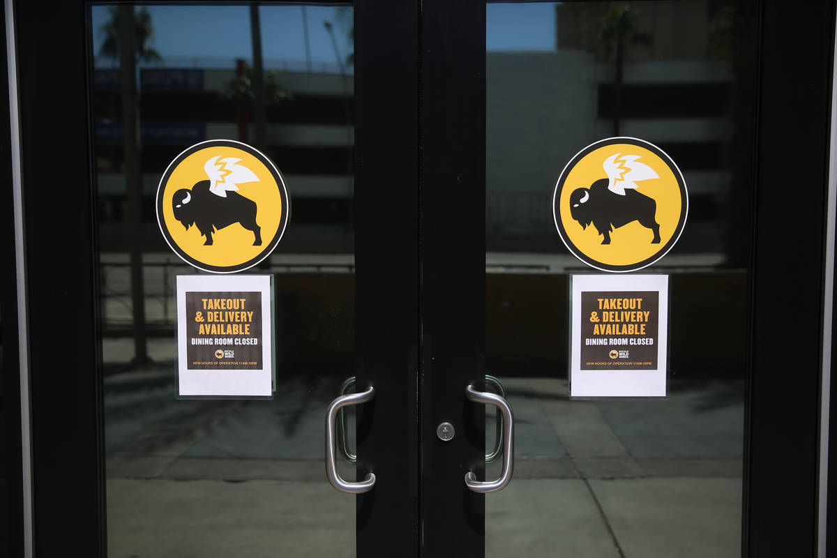 A sign for the open Buffalo Wild Wings in the Miracle Mile Shops in Las Vegas, Thursday, March ...