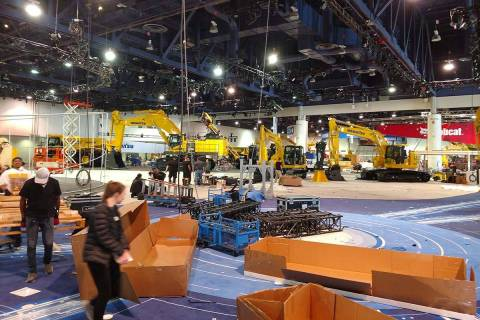 Contract trade show worker and Henderson resident Robert Reinecke worked building the Komatsu b ...