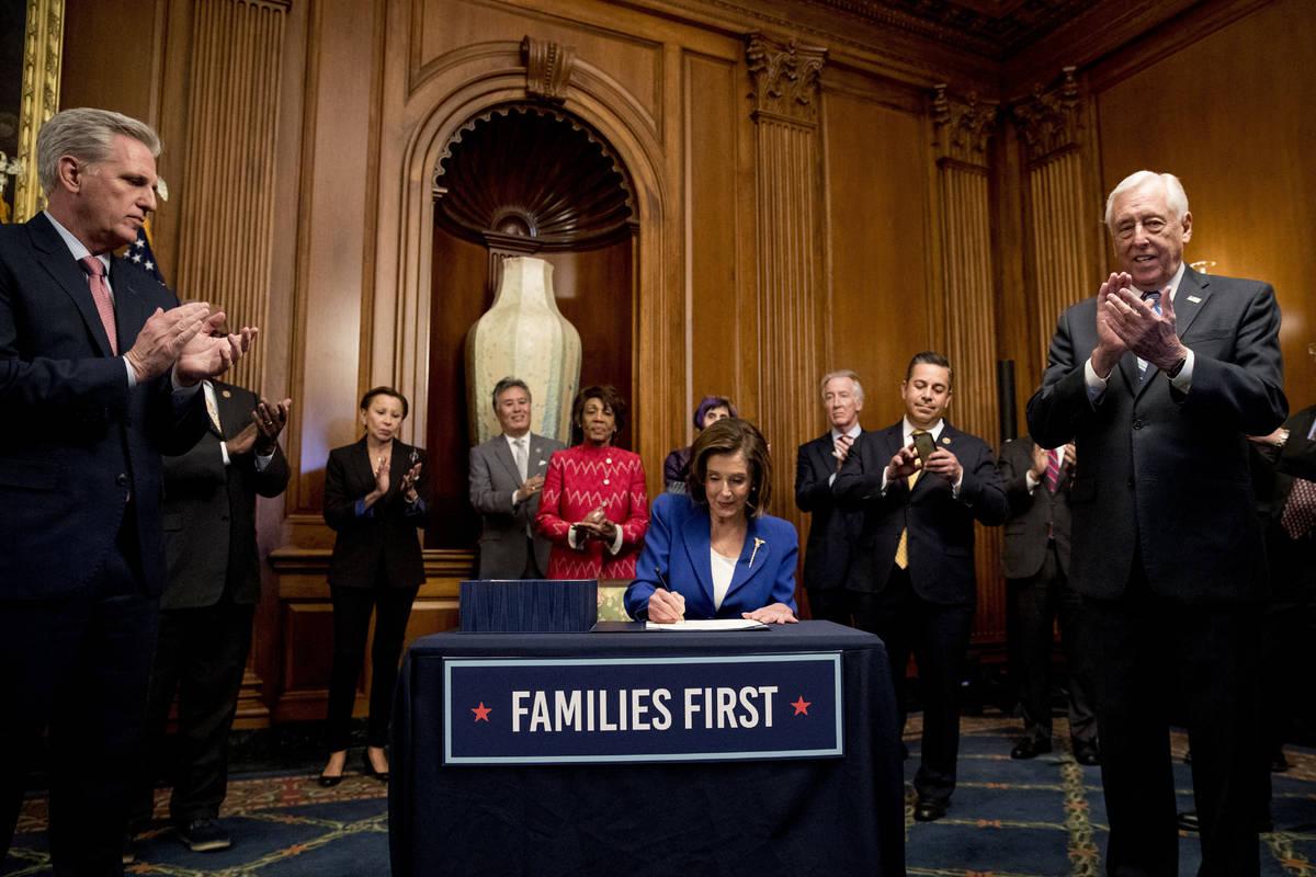 House Speaker Nancy Pelosi of Calif., accompanied by House Minority Leader Kevin McCarthy of Ca ...