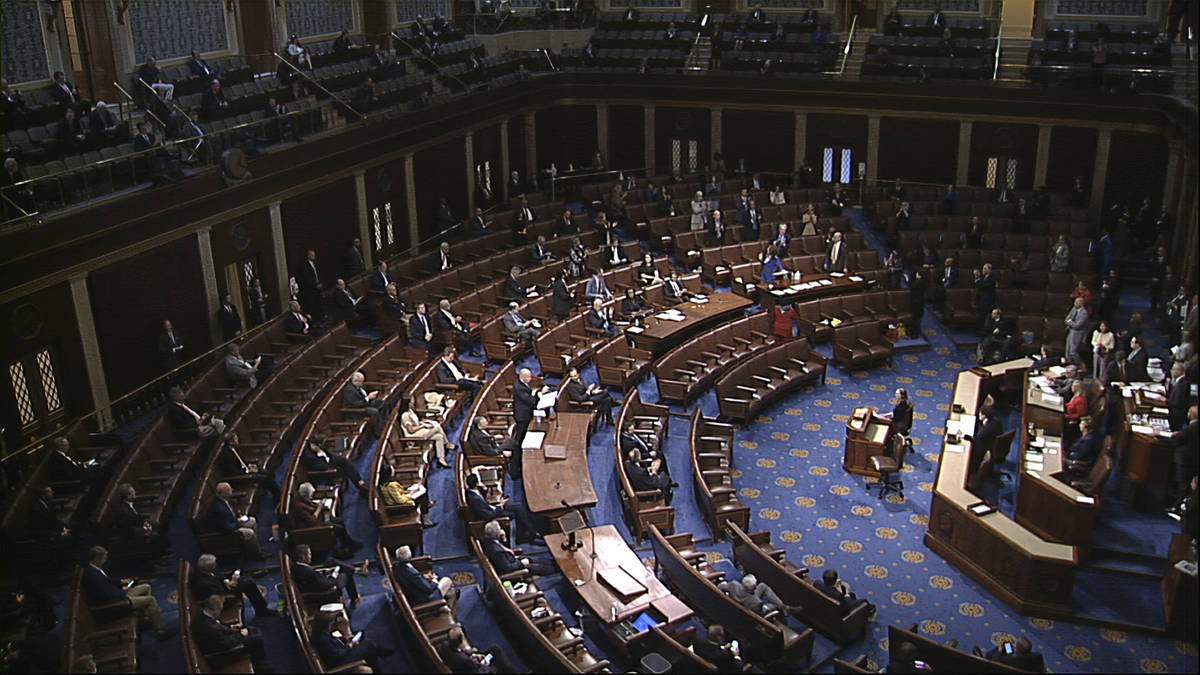 In this image from video, members of the House practice social distancing as they sit on the fl ...