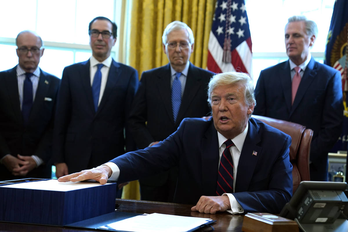 President Donald Trump speaks before he signs the coronavirus stimulus relief package in the Ov ...