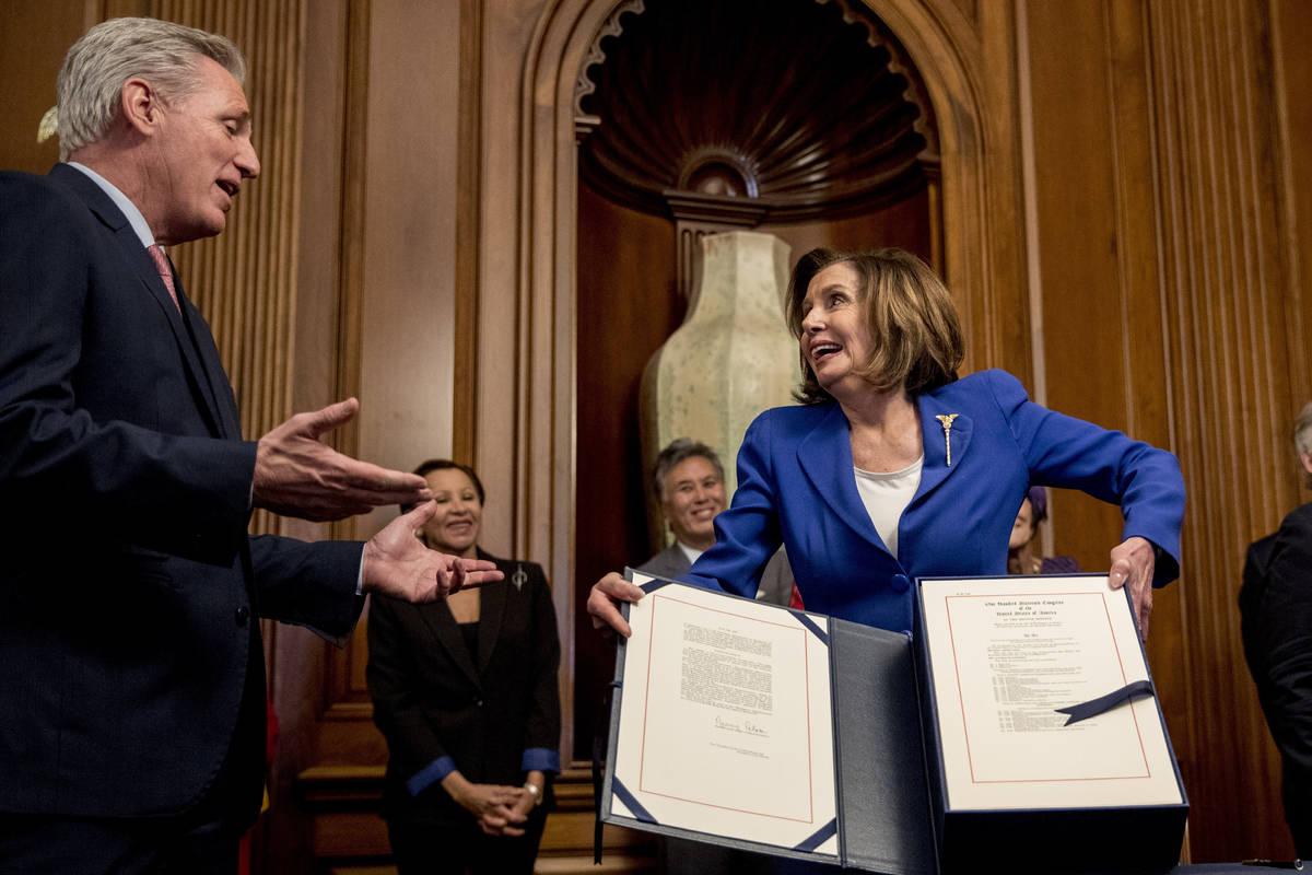 House Speaker Nancy Pelosi of Calif., right, speaks with House Minority Leader Kevin McCarthy o ...