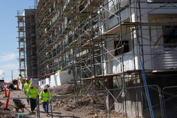 Workers continue construction at a site next to Palms on Friday, March 27, 2020, in Las Vegas. ...