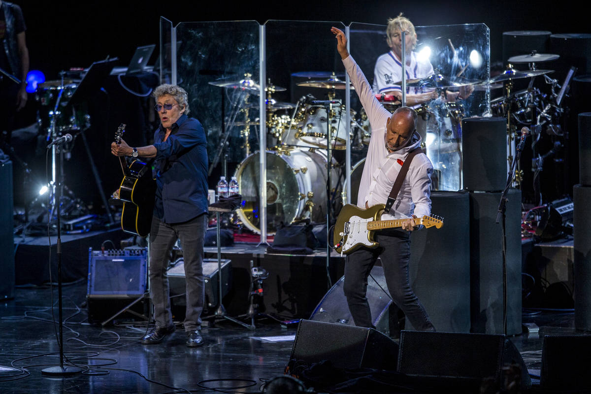 "Roger Daltrey and guitarist Pete Townshend of The Who finish the song ""Who Are You"" at the Colo ..."