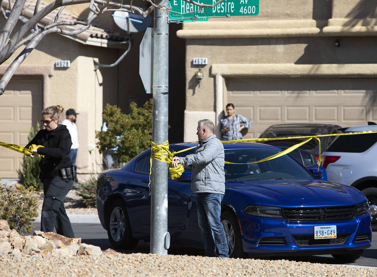 Las Vegas police take down crime scene tape after collecting evidence from the crime scene of a ...