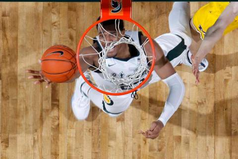 Michigan State's Xavier Tillman pulls in a rebound against Michigan during the first half of an ...