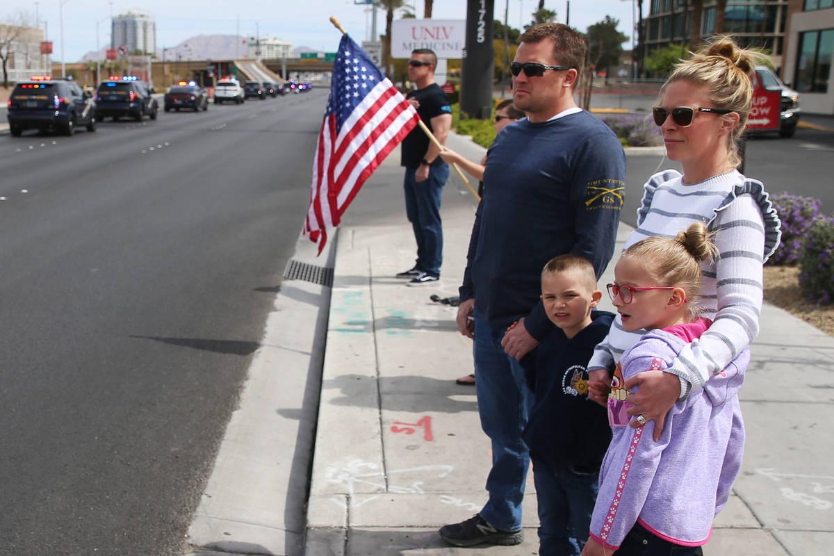 Las Vegas police Sgt. Matthew Harris with his wife Carly, and children Jacob, 5, and Olivia, 6, ...