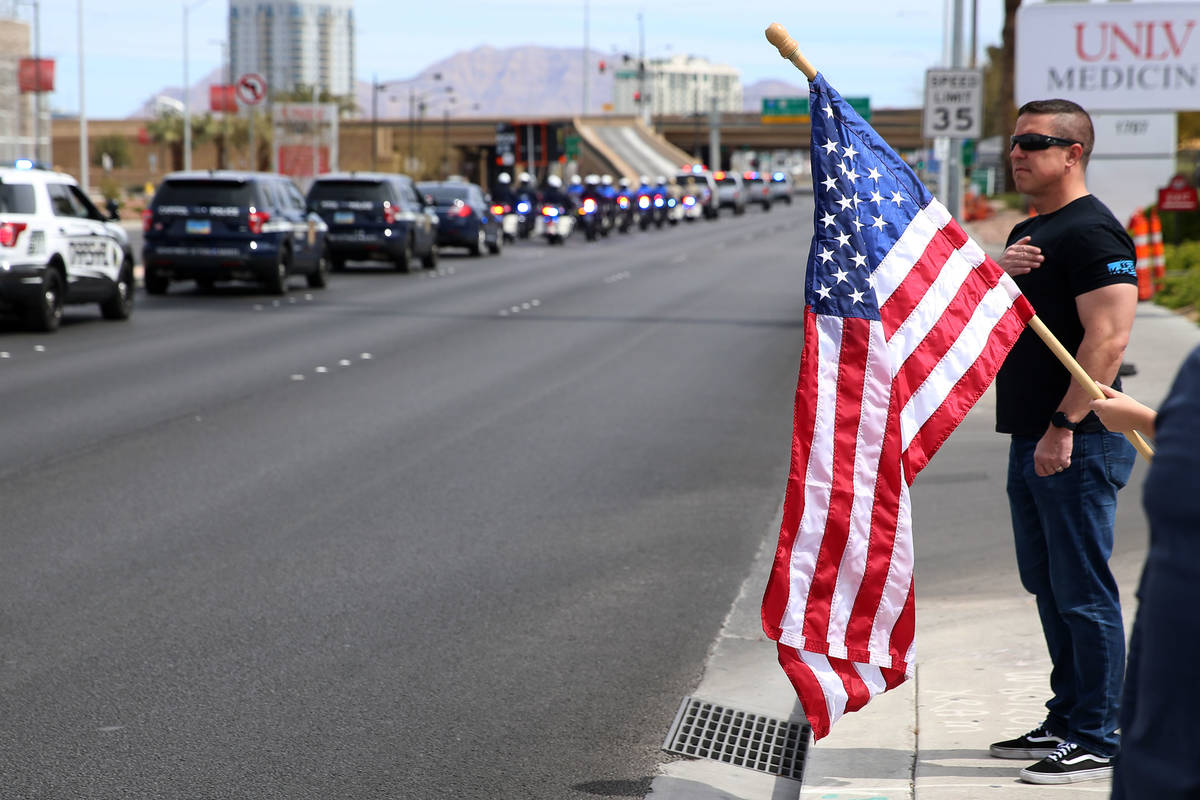 Las Vegas police Lt. Jeff Clark watches the procession for Nevada Highway Patrol Sgt. Benjamin ...