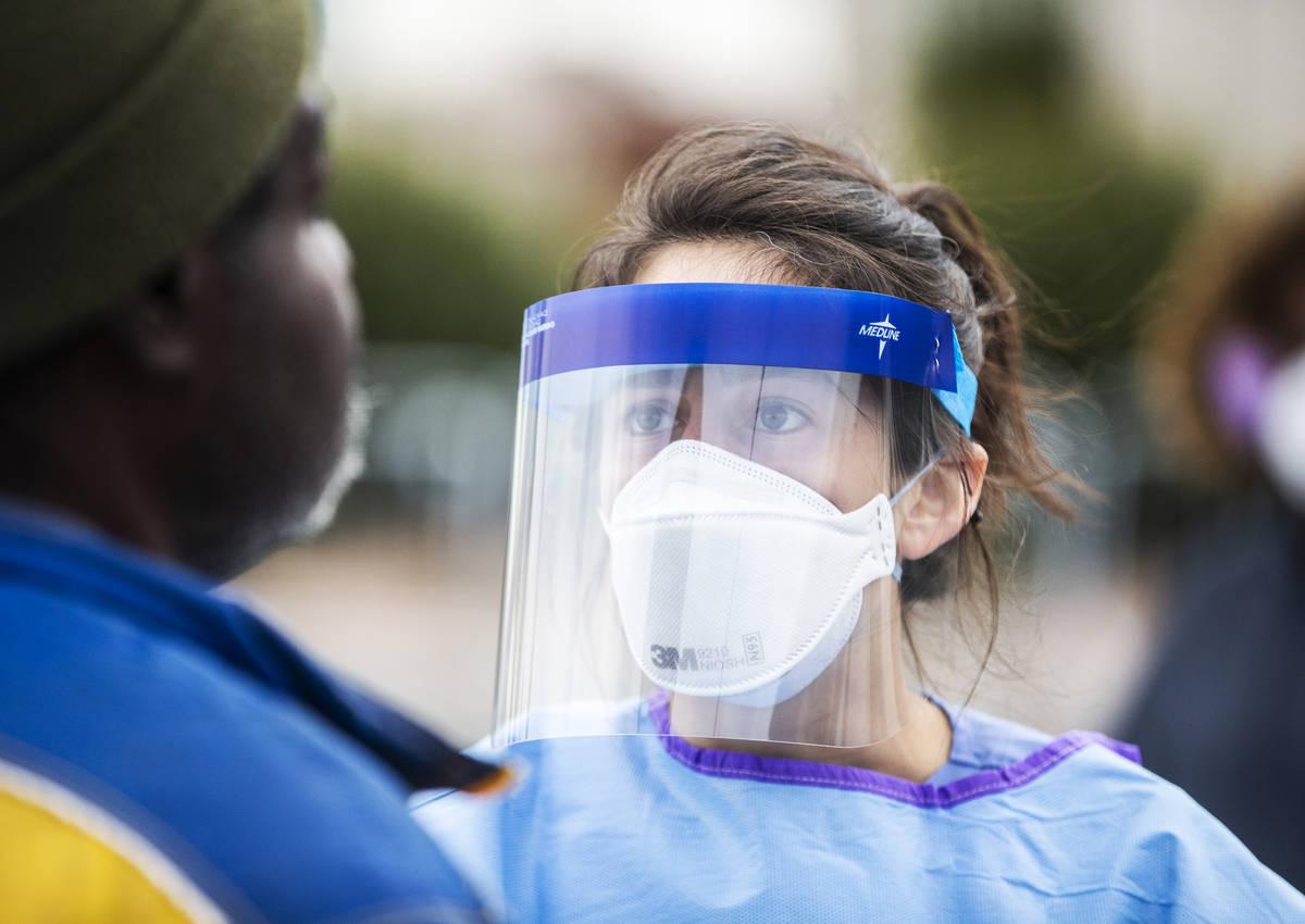 Touro University Nevada medical student Allison Moran screens Micheal Hamilton for signs of the ...