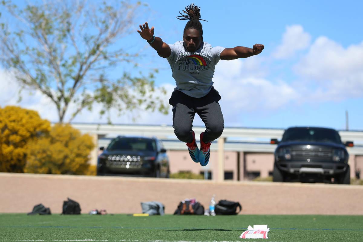 University of Hawai'i football graduate Ikem Okeke tests for his broad jump at the All American ...