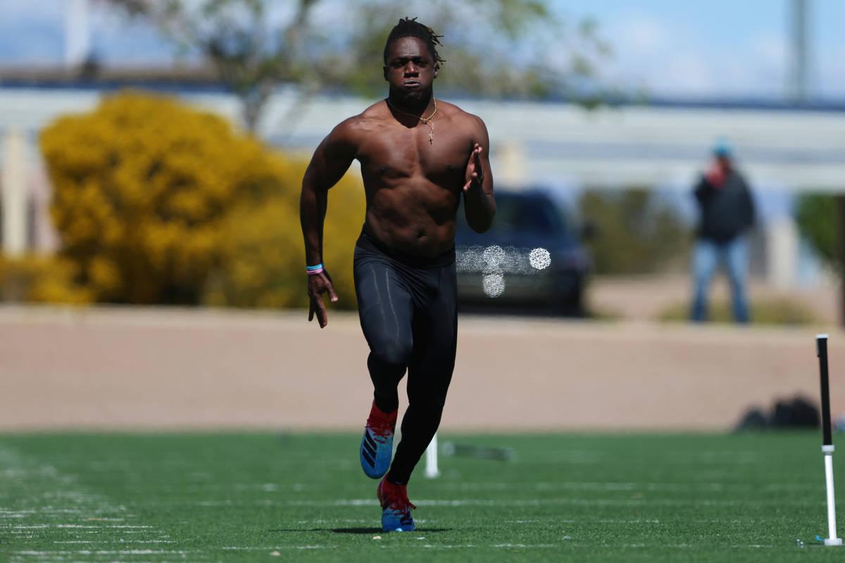 University of Hawai'i football graduate Ikem Okeke runs the 40-yard dash at the All American Pa ...
