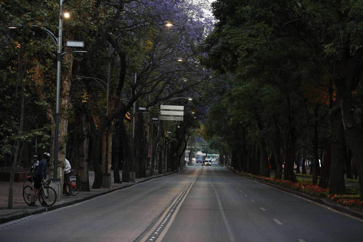 Little traffic is seen on the usually crowded Paseo de la Reforma in Mexico City, at dusk Satur ...