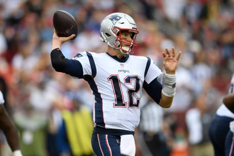 New England Patriots quarterback Tom Brady (12) looks to pass during the second half of an NFL ...
