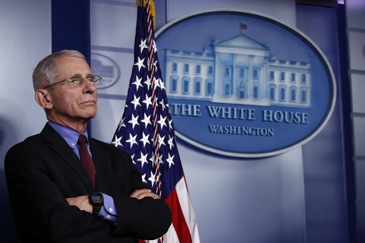 Dr. Anthony Fauci, director of the National Institute of Allergy and Infectious Diseases, liste ...