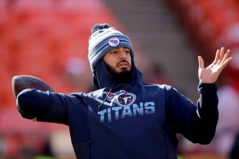 Tennessee Titans' quarterback Marcus Mariota warms up before the NFL AFC Championship football ...