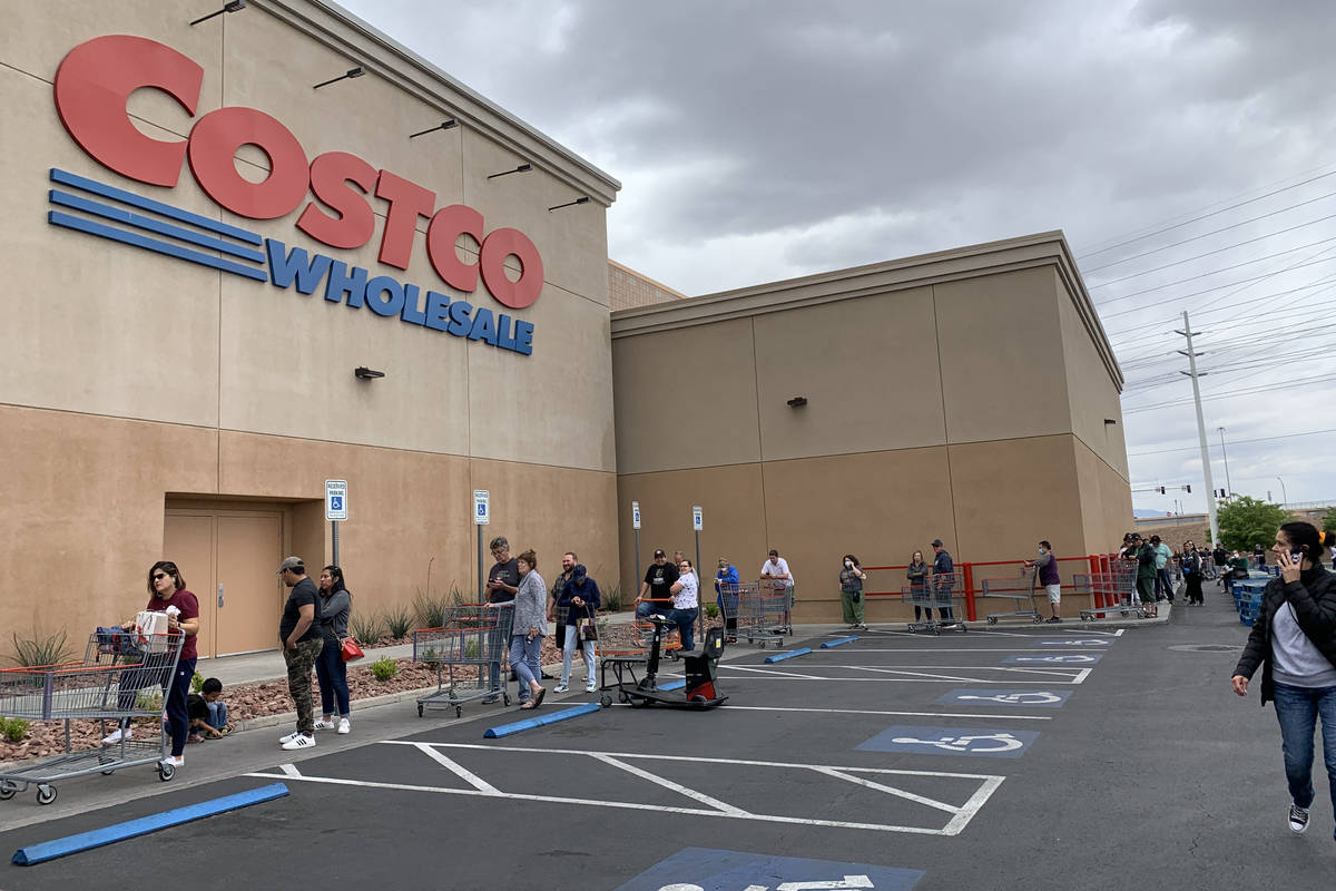 People wait in line in front of Costco at 791 Marks St, in Henderson, Sunday, March 29, 2020. ...