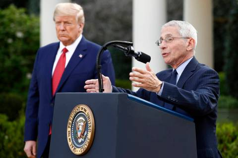 President Donald Trump listens as Dr. Anthony Fauci, director of the National Institute of Alle ...