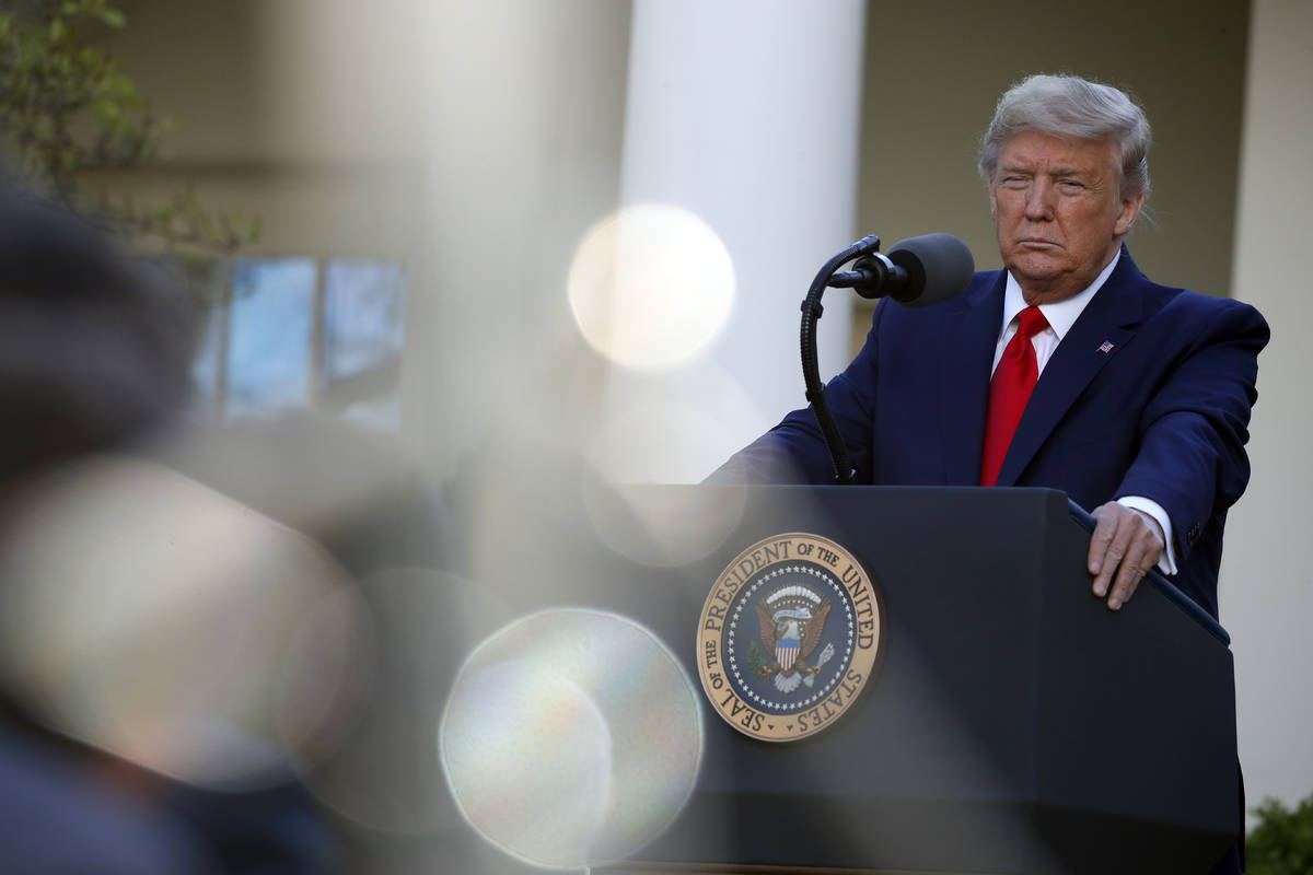 President Donald Trump listens to a question from a reporter as he speaks about the coronavirus ...
