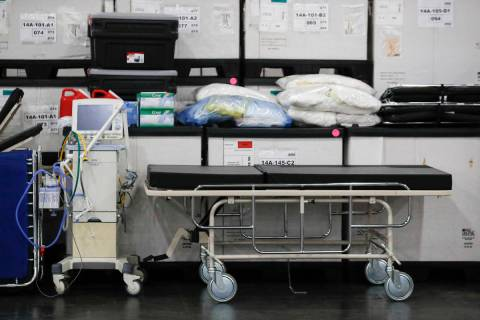 A Monday, March 23, 2020, file photo shows medical supplies and a stretcher displayed before a ...