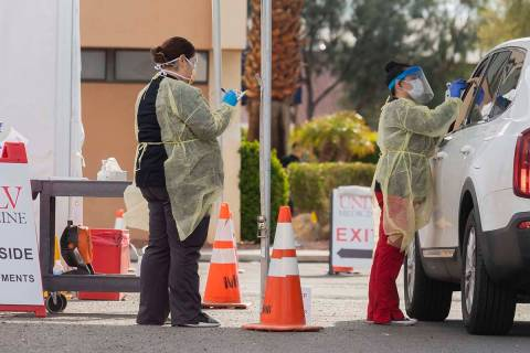 UNLV Medicine medical professionals conduct a curbside test on a patient experiencing coronavir ...
