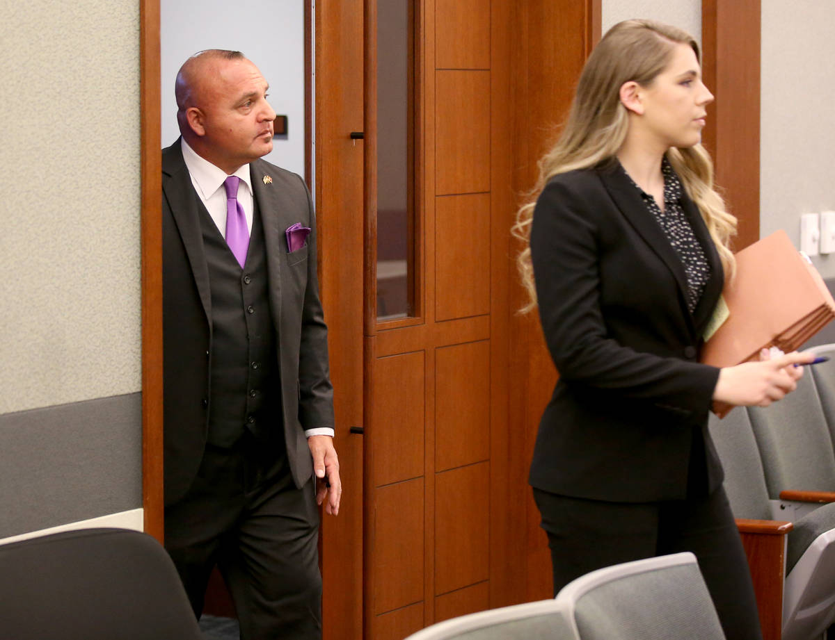 Las Vegas police Detective Lawrence Rinetti Jr. arrives in court with one of his attorneys, Col ...