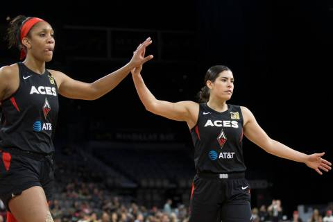 Las Vegas Aces guard Kelsey Plum (10) celebrates with Las Vegas Aces center A'ja Wilson (22) in ...