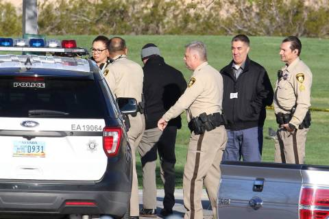 Las Vegas homicide detectives investigate a report of a body at Silverado Ranch Park on Thursda ...